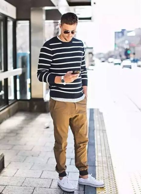 With striped shirt, white sneakers and white t-shirt