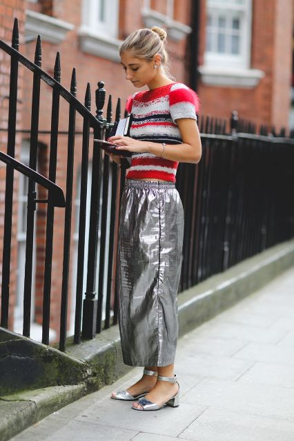 With striped sweater and silver sandals