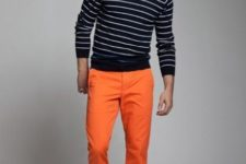 With striped sweatshirt and dark color shoes