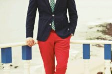 With striped tie, white shirt, navy blue jacket, green socks and brown shoes