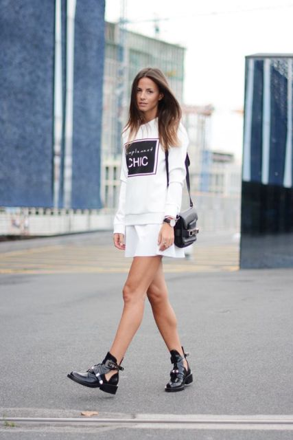 With sweatshirt, white mini skirt and black bag
