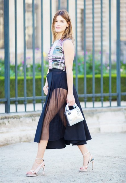 With top, sheer skirt and heels
