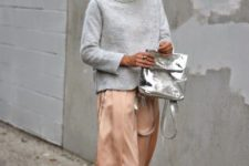 With turtleneck, silk skirt and neutral color sandals