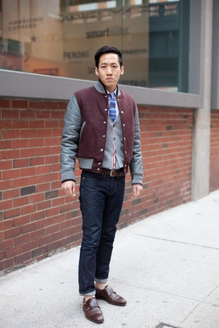 With two color bomber jacket, jeans and belt