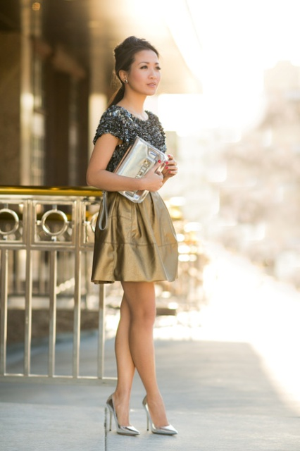 With unique shirt, golden skirt and metallic shoes
