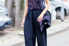 With unique top, navy blue pants and printed bag