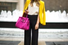 With white blouse, black wide-leg pants and purple bag