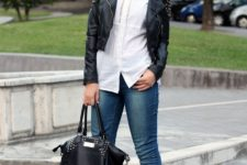 With white blouse, leather jacket, cuffed jeans and bag