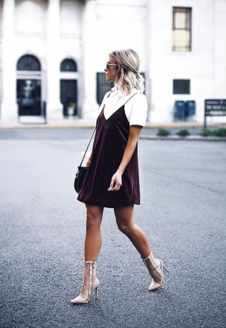With white blouse, mid calf boots and bag