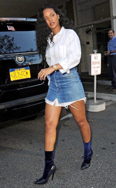 With white button down shirt and denim skirt