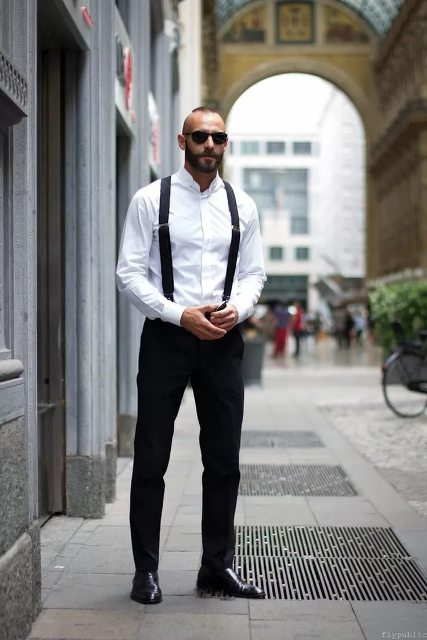 With white button down shirt, black suspenders and shoes