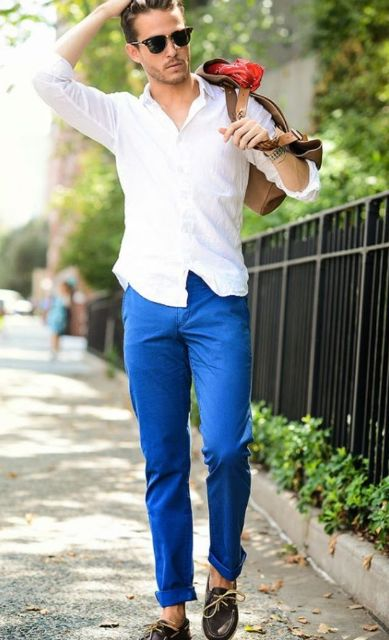 With white button down shirt, loafers and brown bag