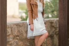 With white dress and brown leather jacket