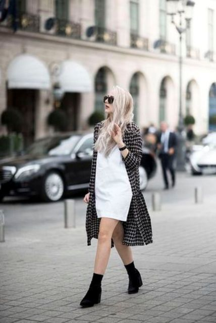 With white dress and long printed jacket