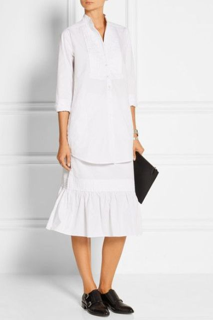 With white long shirt, midi skirt and black clutch