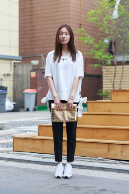 With white loose shirt, crop pants and white sneakers