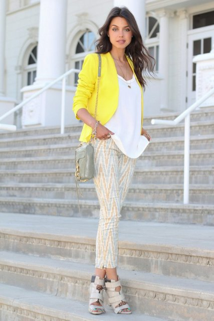 With white loose shirt, printed crop pants and small bag