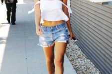 With white off the shoulder top and denim shorts