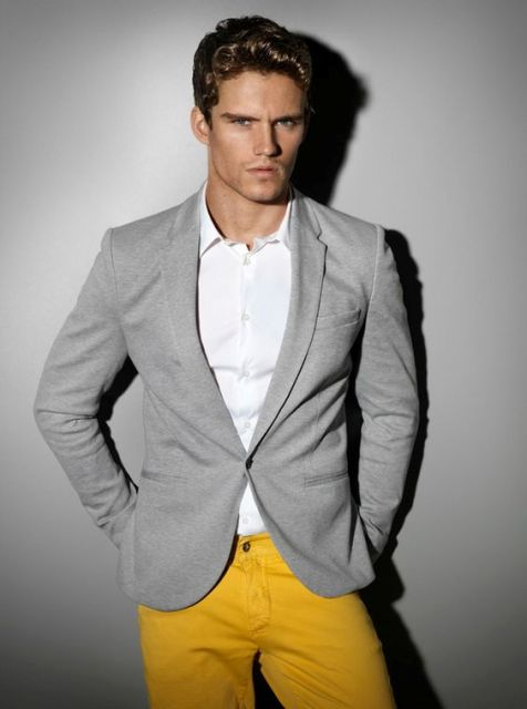 With white shirt and gray blazer