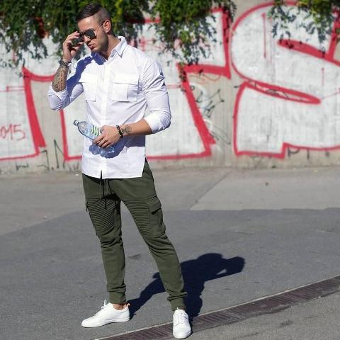 With white shirt and white sneakers