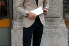 With white shirt, dark color tie, beige blazer and brown loafers
