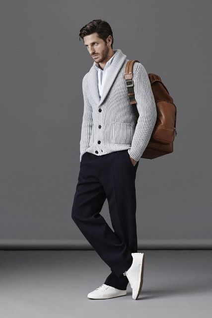 With white shirt, gray cardigan, white sneakers and brown backpack