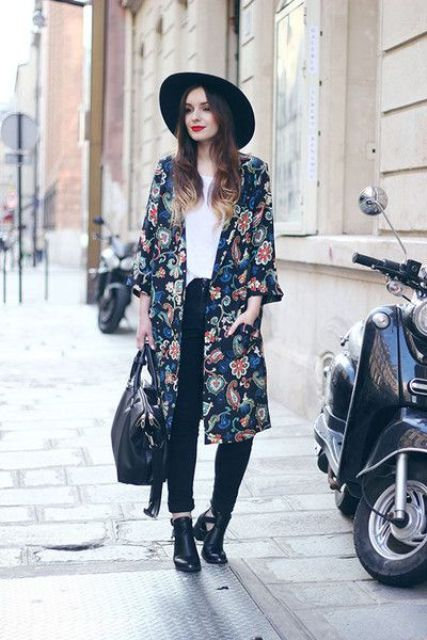 With white shirt, jeans, floral coat and wide brim hat