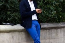 With white shirt, navy blue jacket and light gray shoes