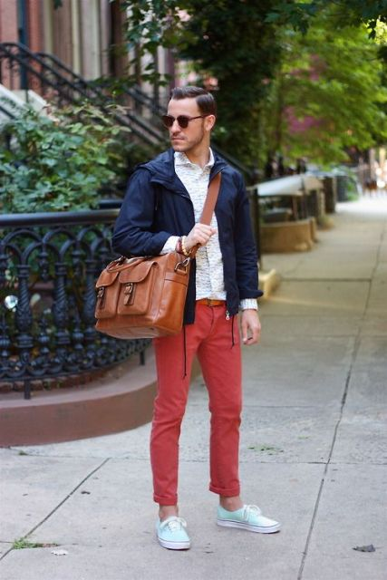 With white shirt, navy blue sporty jacket and big leather bag