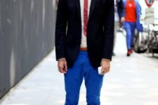 With white shirt, red tie, black blazer, striped socks and brown shoes