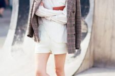 With white shorts, white shirt, checked blazer and red clutch