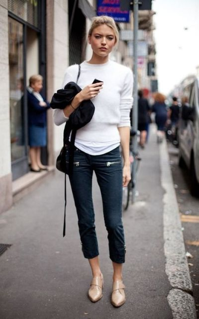 With white sweater, crop jeans and black bag