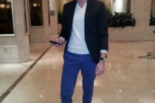 With white sweatshirt, black blazer and black loafers
