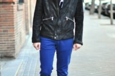 With white t-shirt, black leather jacket and mid calf boots