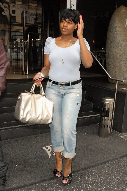 With white t-shirt, cuffed jeans and sandals