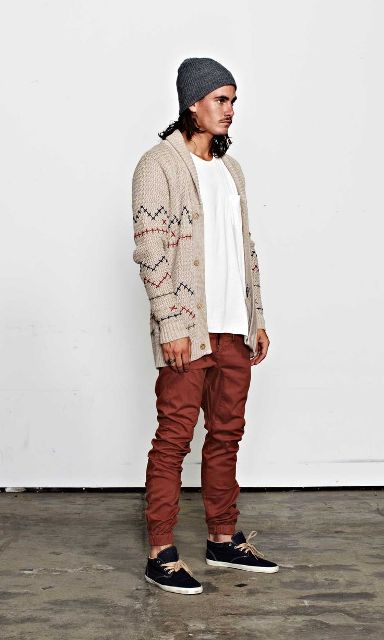 With white t-shirt, geometric printed jacket, gray hat and black shoes