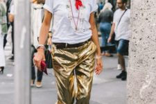 With white t-shirt, golden heels and red clutch
