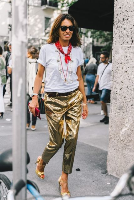 With white t shirt, golden heels and red clutch