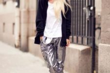 With white t-shirt, long jacket and black heels