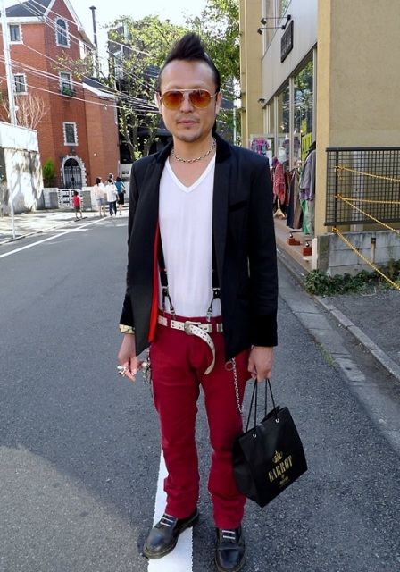 With white t-shirt, navy blue blazer and black shoes