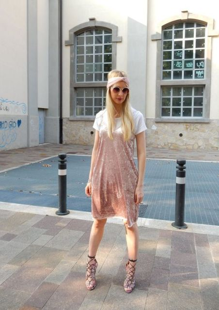With white t-shirt, original sandals and pale pink headband