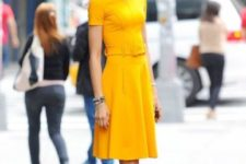 With yellow knee-length dress