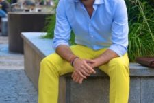 With yellow pants and light blue shirt