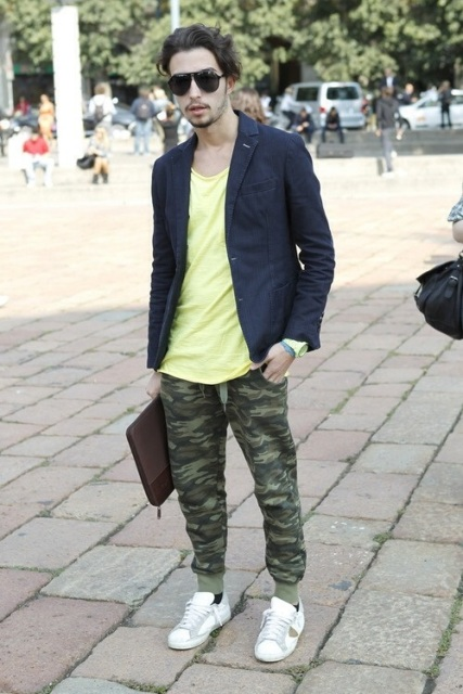 With yellow shirt, navy blue blazer and sneakers