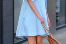dusty blue off the shoulder dress with ties on arms, brown leather shoes and a bag