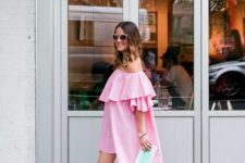 pink off the shoulder ruffle dress, blush heels and a blutch