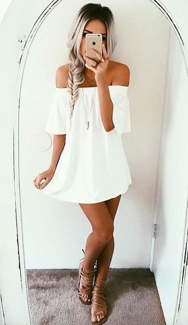 simple white mini dress with short sleeves and lace up sandals for a boho look