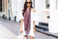 white pompom rim mini dress, neutral lace up heels and a printed scarf