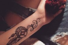 02 a boho dream catcher arm tattoo