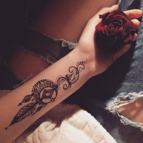 a boho dream catcher arm tattoo